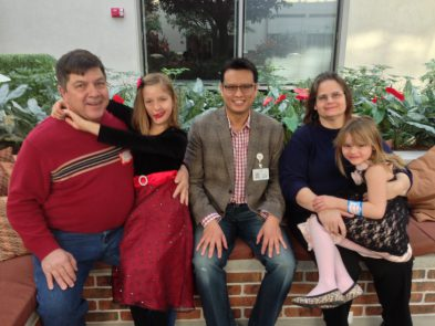 Charlotte and family enjoy a visit with Dr. Chiayasate at the Beaumont for Children's Holiday Party.