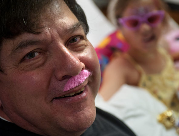 Tim and Charlotte Ponce celebrate her 12th birthday at Beaumont Hospital with pink mustaches.